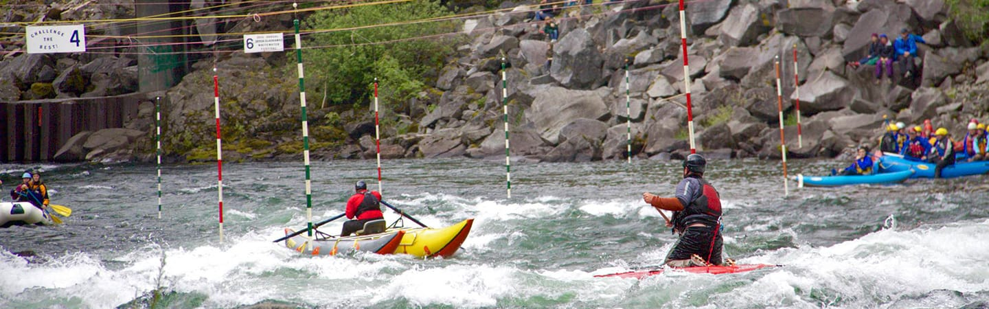 Boaters competing in Carter Falls at the Upper Clackamas Whitewater Festival