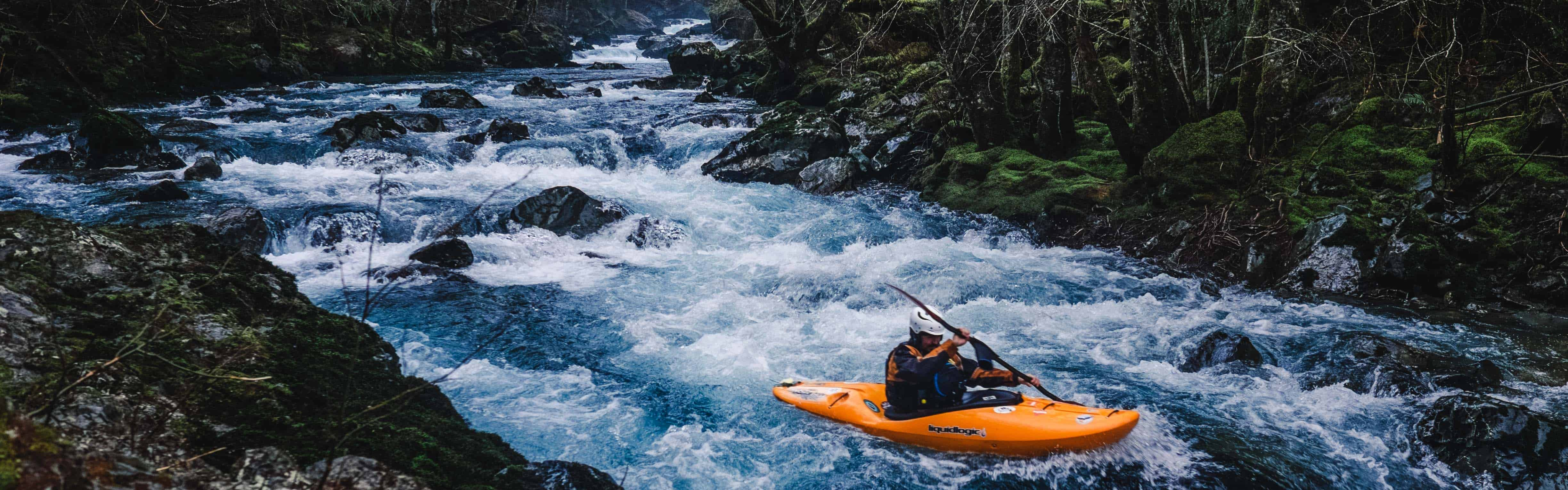 A paddler at the put in rapid on the Hamma Hamma River. Photo by Nate Wilson Photography